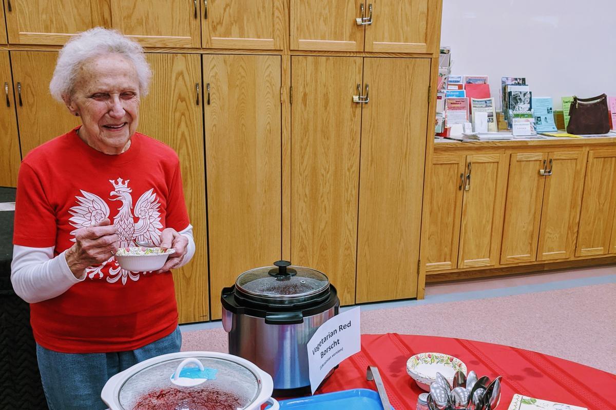 Our volunteer Eleanor B. tasting the red borscht