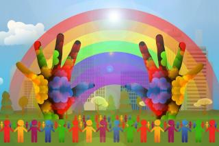 A rainbow with colorful hands and colorful human silhouettes in front of it.